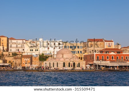 CRETE,  GREECE - JULY 22, 2015:  Venetian harbor of Chania with the Janissaries Mosque (XVII century)