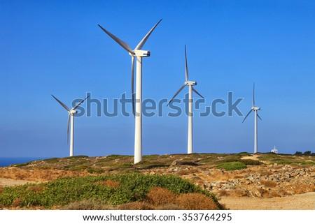 Crete island, Greece: windsmills in mountains over the sea - stock photo