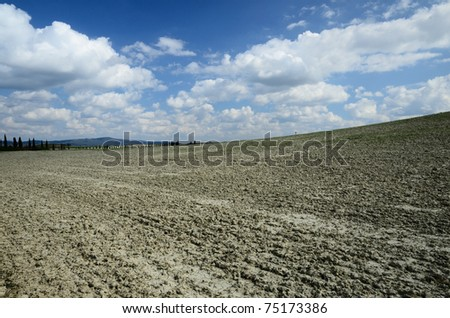 """Crete Senesi Crete Senesi are literally """"Siennese clays"""" and the distinctive gray coloration of the soil gives the landscape an appearance often described as lunar - stock photo"""