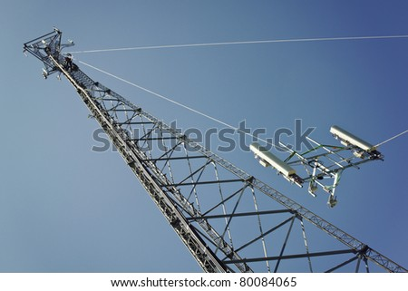 Crew installing boom with antennas on the cell tower - stock photo