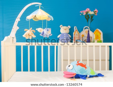 Crib and soft baby toys at children's room. Toys are officially property released. - stock photo