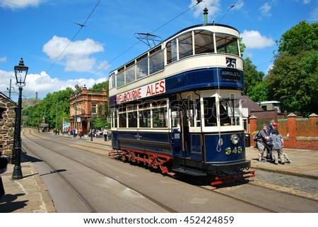 CRICH, ENGLAND - JULY 5. The National Tramway Museum features historic tramcars from Leeds and Blackpool on July 5, 2016, Crich, England. - stock photo