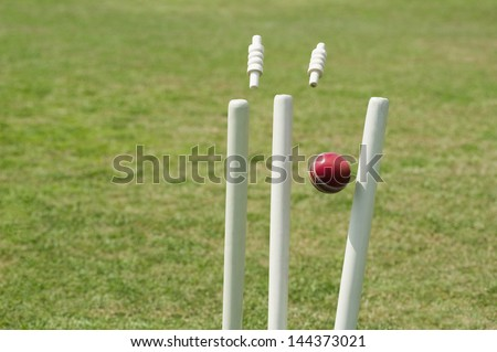 Cricket ball hitting stumps - stock photo