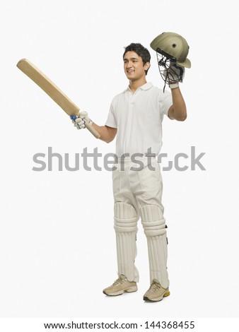 Cricket batsman celebrating his success - stock photo