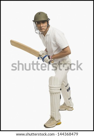 Cricket batsman playing a defensive stroke - stock photo
