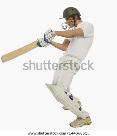Cricket batsman playing a square cut shot - stock photo