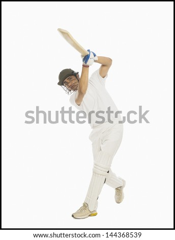 Cricket batsman playing a straight drive