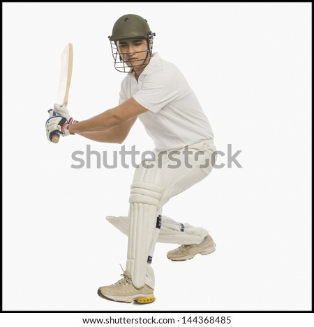 Cricket batsman playing a stroke - stock photo