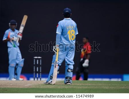Cricket batsmen in action - stock photo
