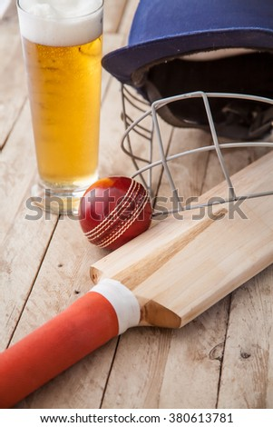 Cricket Equipment on wooden table