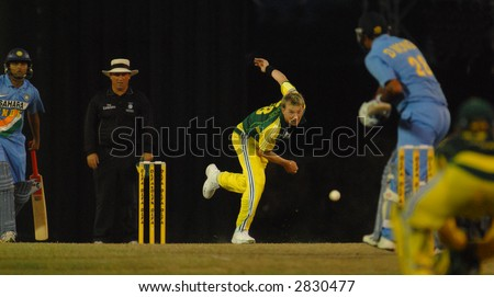 Cricket players in action during the final of their tri-nations cricket series in Kuala Lumpur - stock photo
