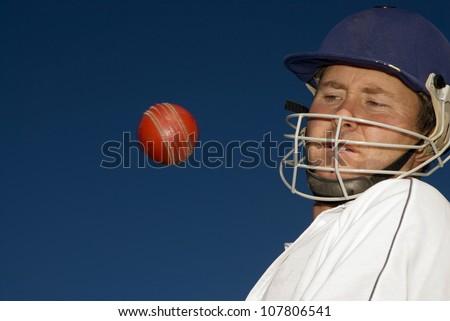 Cricketer evades a bouncer - stock photo