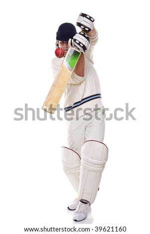 Cricketer playing a shot, studio shot on white background.