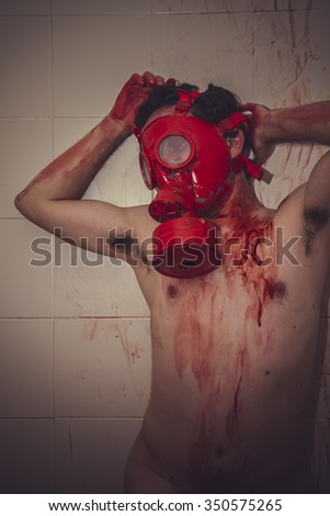 crime naked man with red gas mask, blood, despair and suicide - stock photo