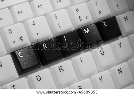 Crime phrase on a keyboard - stock photo