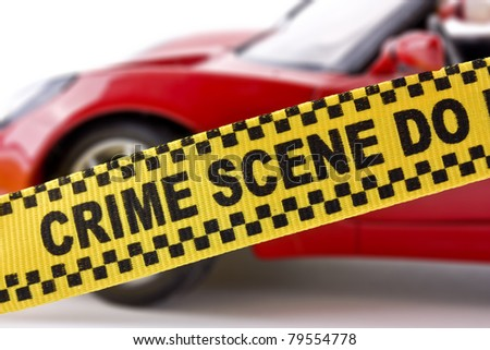 Crime scene banner over car close up
