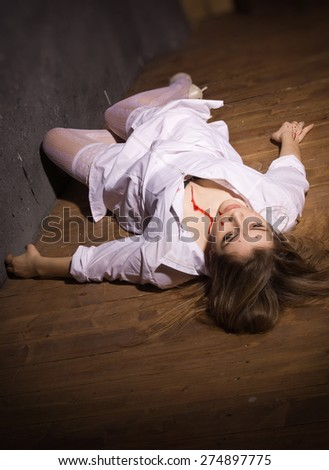 Crime scene. Dead nurse lying on the floor. Low key