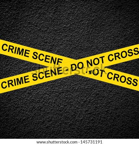 CRIME SCENE - DO NOT CROSS against black wall - stock photo