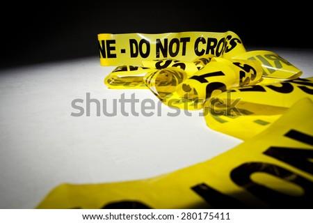 Crime scene 'Do not cross' tape - stock photo