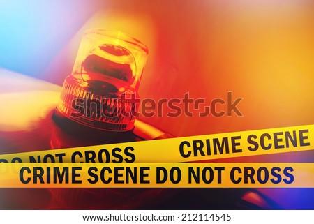 Crime Scene Do Not Cross Yellow Headband Tape and Orange flashing and revolving light. Criminal Scene Police Ribbon. - stock photo