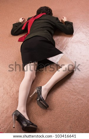 Crime scene imitation. Killed business woman lying on the floor