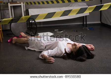 Crime scene imitation. Nurse lying on the floor