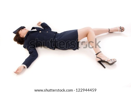 Crime scene imitation. Woman officer lying on a floor - stock photo