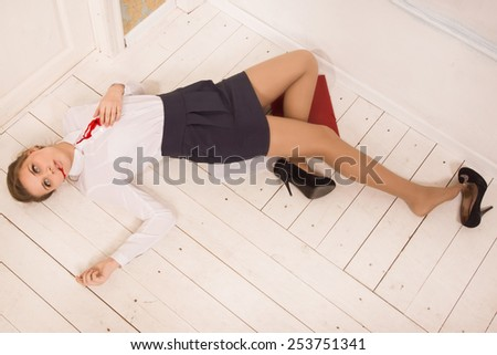 Crime scene in a office with body of lifeless secretary - stock photo