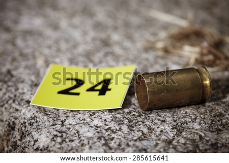 Crime scene investigation - cartridge as evidence - stock photo
