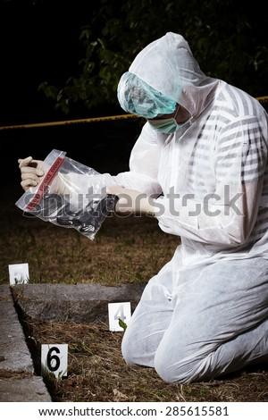 Crime scene investigation - handgun found - stock photo