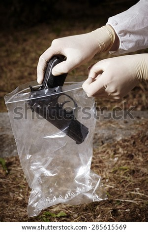Crime scene investigation - handgun outdoor - stock photo
