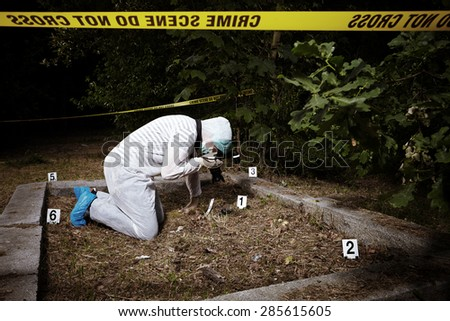 Crime scene investigation - photographer criminologist on place of crime - stock photo