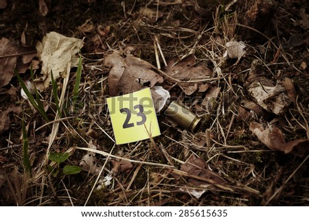 Crime scene investigation - .45 pistol cartridge - stock photo