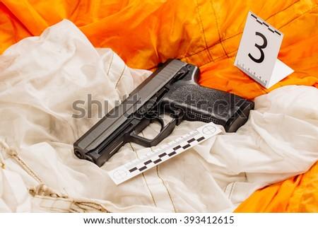 Crime scene investigation - pistol evidence - stock photo