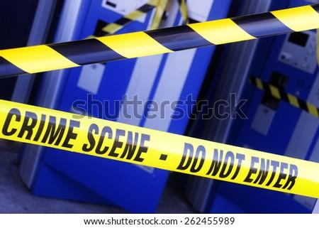 Crime scene investigation police boundary tape at the scene of a break in and burglary - stock photo