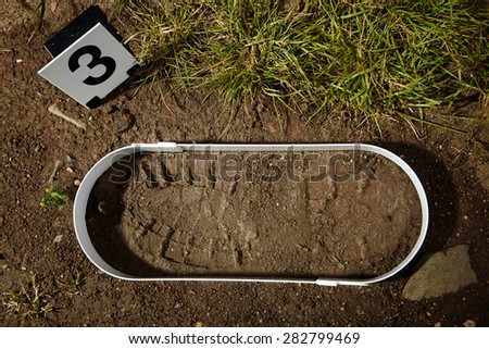 Crime scene investigation - Taking care of footprint - stock photo