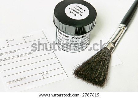 Crime scene investigation tools.   Latent fingerprint powder, fingerprint incident sheet and brush - contrast and texture added for effect. - stock photo