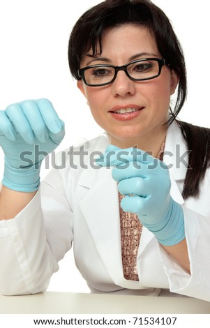 Crime scene investigator or forensic criminologist expert holding a fingerprint sample exposed with latent powder and lifted with tape.  White background.