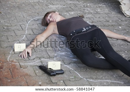 crime scene - killed woman outlined on the ground - stock photo