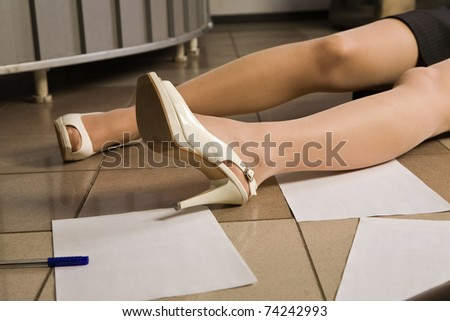 Crime scene. Legs of the lifeless woman. - stock photo