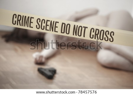 crime scene - nude dead woman with gun lying on the ground - stock photo