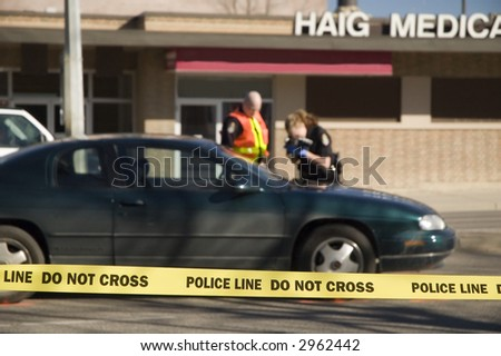 Crime scene photographer documenting an accident. - stock photo