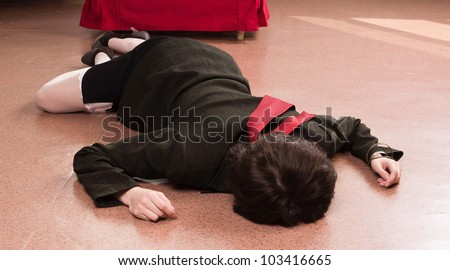 Crime scene simulation: killed businesswoman in a office - stock photo