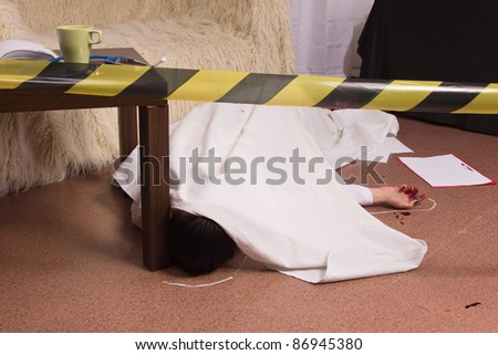 Crime scene simulation: victim lying on the floor - stock photo