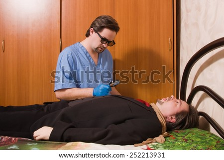 Crime scene with forensic investigating a crime on a businessman - stock photo