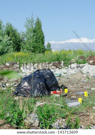 Crime scene with male corpse and evidence markers - stock photo