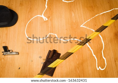 Crime scene with the silhouette of the victim circle  - stock photo
