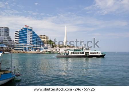 CRIMEA, SEVASTOPOL, JUNE 13, 2014: Passenger boat plying in the Sevastopol Bay - stock photo