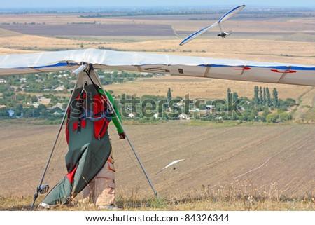 CRIMEA, UKRAINE - SEPTEMBER 7: Competitor  of the Grininko hang gliding competitions takes part on the Klementieva mountain on September 7, 2011 in Crimea, Ukraine - stock photo