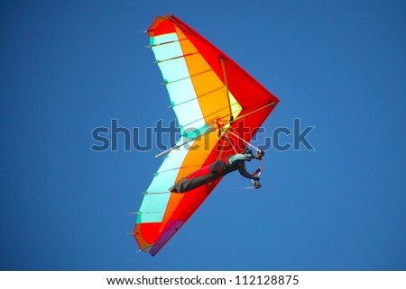 CRIMEA, UKRAINE - SEPTEMBER 4: Competitor Victor Parhomenko of the Grininko hang gliding competitions takes part in the Klementieva mountain on September 4, 2012 in Crimea, Ukraine - stock photo